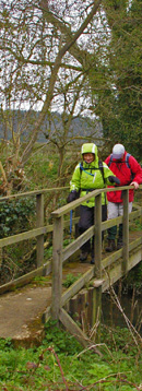 Pam & Bob on the footbridge over Nunburnholme Beck/ from a photo by Arnold Underwood, April 2008